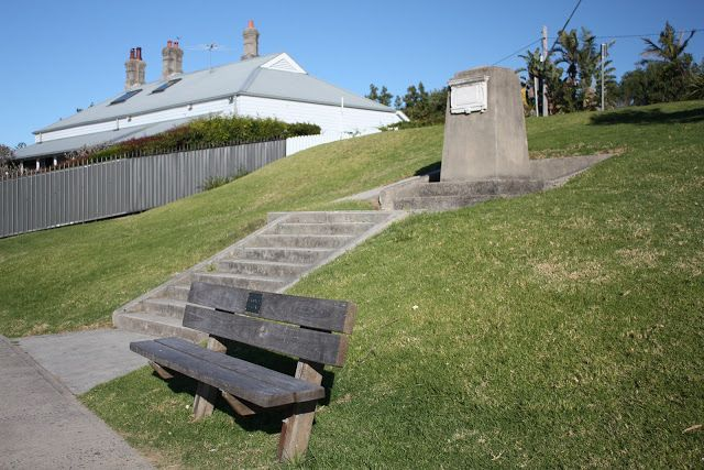 This monument is located in Green Point Reserve, overlooking Camp Cove in the eastern suburb of Watsons Bay. It commemorates the first landing point in Sydney Harbour of Arthur Phillip and the First Fleet. The stone plaque reads: On this beach (Camp Cove), Governor Phillip first landed in Port Jackson Jan. 21 1788. R.A.N.S.