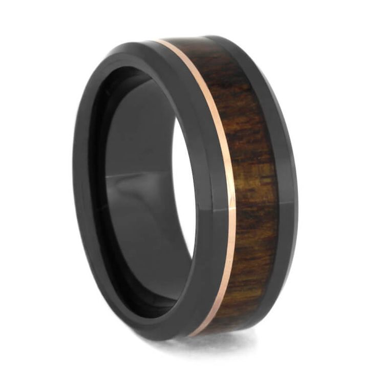 Caribbean rosewood is inlaid into this mysterious black ceramic wedding band. A thin 14k rose gold accents the wooden inlay beautifully and adds a...