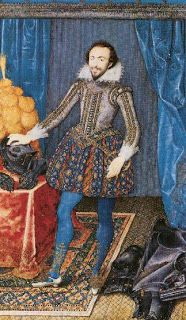 Renascimento - Era Elizabetana. O homem usava o gibão, camisa com colarinho e pulso com babados, jaqueta sem manga, espécie de meias calças, capa, mandilion, sapato arredondado ou botas que começavam a ter saltos e chapéu.
