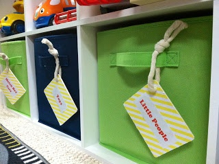 Playroom Organization. Put picture of items in drawer on tab so kids can help put away