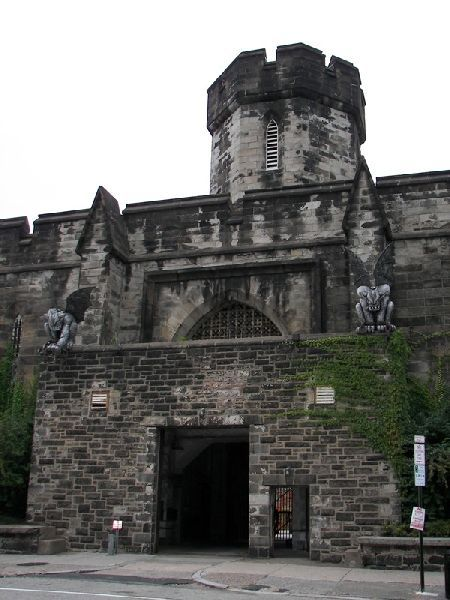 Front gate of Eastern State penitentiary in Philadelphia, PA. The gargoyles are part of a haunted Halloween attraction that the city does to raise funds every year.