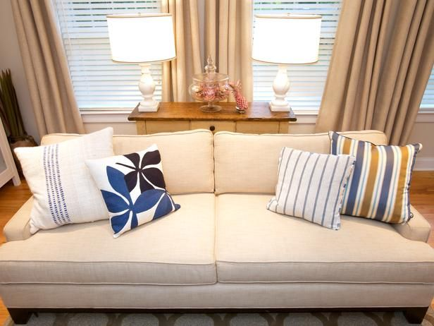 beachy blue and gold pillows add color splash to neutral couch portfolio hgtv home u0026 garden television