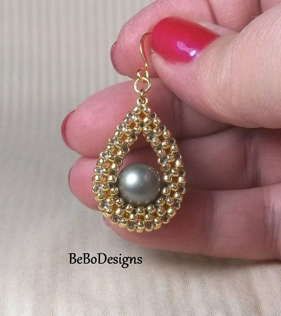 Swarovski Powder Green Pearl Teardrop Bead Woven Earrings/Seed Bead Earrings/Cubic Right Angle Weave Earrings Elegant and classic teardrop earrings are made with Toho Starlight permanent galvanized seed beads and feature a 10mm Swarovski Powder Green pearl nestled in the beadwork. The
