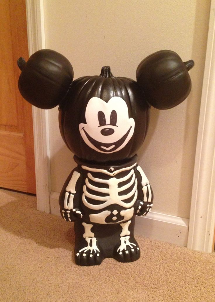 Pumpkin Skeleton Mickey Mouse  made with fake pumpkins and white paint.  So creative!