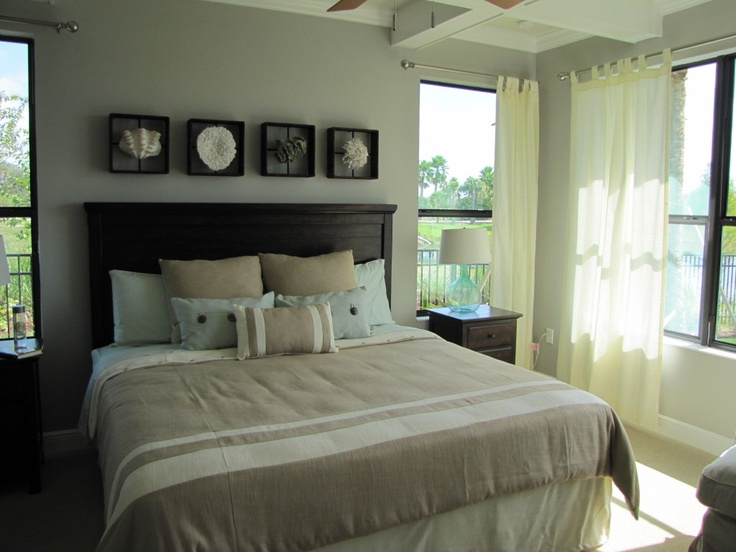 Florida Style bedroom decorating tips - I like the accessories above the headboard
