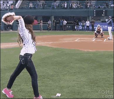 Girl-baseball-pitch A girl fails badly at pitching a baseball