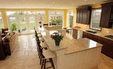 love the open plan into living area and wall of doors that easily opens to patio  don't like short counter space at barstools