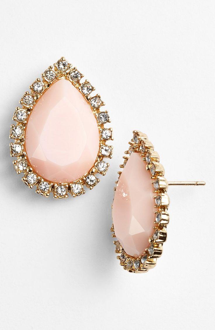 blush Kate Spade stud earrings.