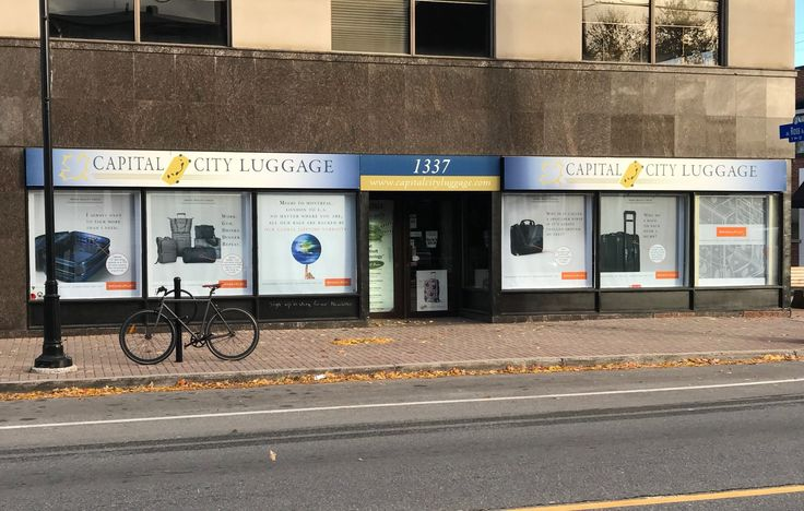 Captial City Luggage had these custom printed roller blinds were installed to their 6 storefront windows by Speedpro Imaging Ottawa. Impressive!