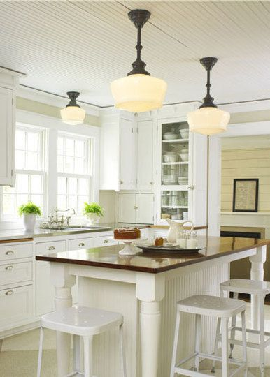 TASK - Ceiling Fixtures (Kitchen lighting idea by contrasting height on the same fixture rather than all the same height.)