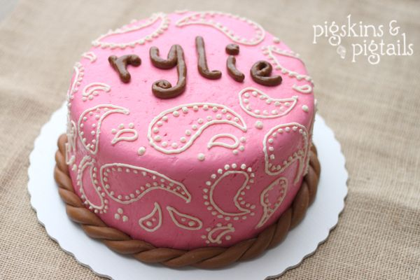 Could you do this cake but with that name banner on it and add some black to it, since her favorite color is black?