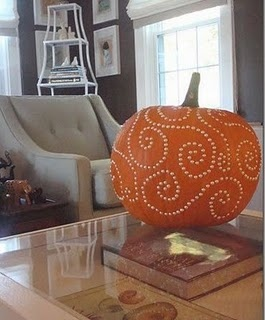 Drill bit pumpkin.  (if I can find a good size pumpkin that doesn't cost more than 5 gallons of milk, I'll try this)