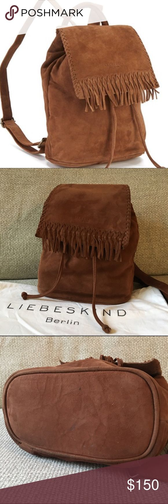 """Liebeskind suede fringe backback Super soft suede backpack in great condition. Beautiful brown/cognac hue. Flap top with fringe trims. Magnetic snap and drawstring closure. Top handle + adjustable straps. Interior has two open pockets and one zipper pocket. 100% suede leather. Measurements: L 9"""", H 11"""", W 4½"""". Minor specks of scratches on the bottom (as shown in photo). Will ship with original dust bag. Liebeskind Bags Backpacks"""