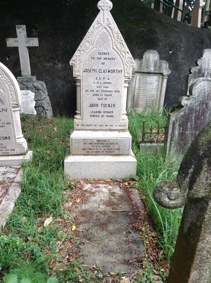 """Tombstone of Joseph Clatworthy, Chief Engineer, Royal Artillery (C.E.R.A.), of """"HMS Archer"""", who died on 18 February 1898, aged 31 years, also John Tucker, Leading Stoker, who died and was buried at WuHu (蕪湖), prefecture-level city in southeastern Anhui province, China, sitting on the southeast bank of the Yangtze River."""