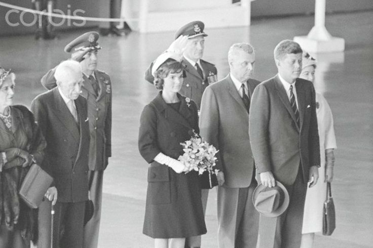 President and Mrs. Kennedy with President and Mrs. John Diefenbaker. President and Mrs. John Kennedy; Prime Minister and Mrs. John Diefenbaker stand during playing of the National Anthem, shortly following the Chief Executive's arrival here May 16. In the back is Group Captain C.H. Mussells