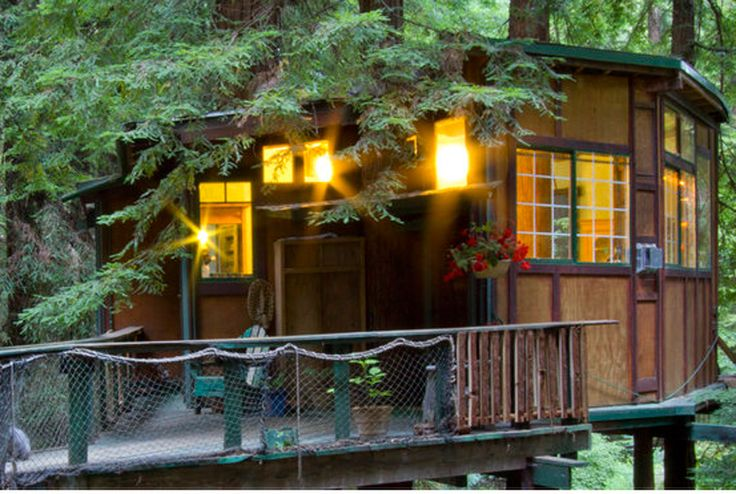 Where: Watsonville, California Accommodates: 2 Why we love it: This environmentally friendly treehouse is located in the midst of a redwood forest in the Santa Cruz Mountains. Spend the day hiking outdoors, and relax in the treehouse's hot tub (yes, you read that right!) at night. Book it! - CountryLiving.com