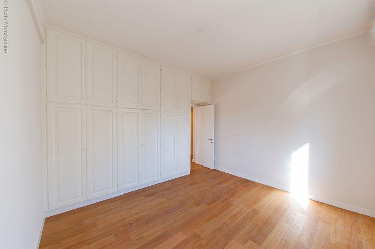Bedroom: Wardrobe custom designed for space optimization