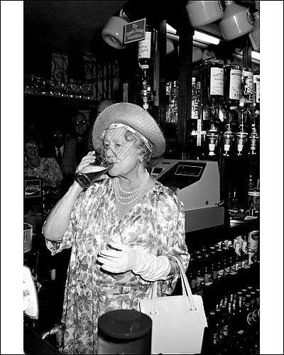 "Hitler called her ""The most dangerous woman in Europe.""  At The Queens Head pub in Stepney, in London's East End, Her Majesty Queen Elizabeth The Queen Mother enjoyed a pint of bitter, which she pulled herself. (That's the much-missed late mother of QE II, who famously refused to leave London during the Blitz, or even to send her daughters to the safety of Canada, saying """"The children won't go without me. I won't leave the King. And the King will never leave."" ~"