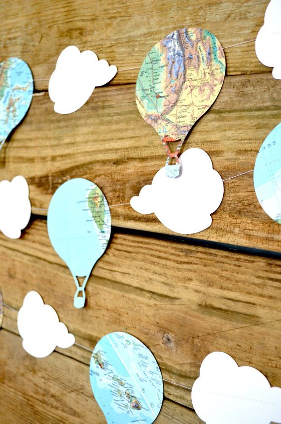 Hot Air Balloons and Clouds Vintage Map Garland, classic adventure party decor: Let your event (and imagination) take flight with this darling banner!  We hand make these garlands using clouds cut from white card stock and hot air balloons from vintage atlases.