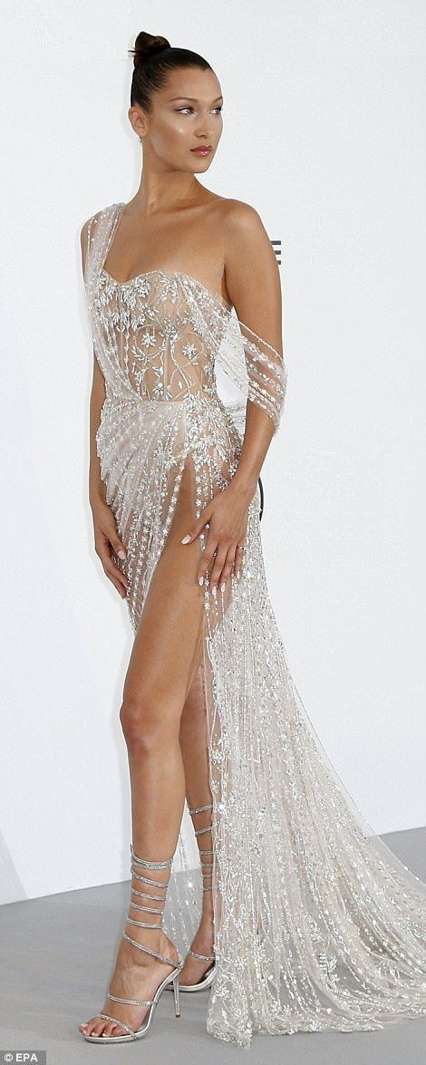 Lovely clear crystal embellished gown with a draping train and sky-high slit.