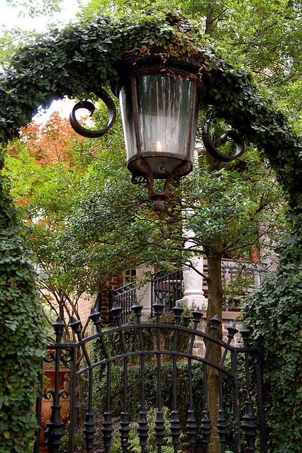 A romantic old wrought iron gate entrance to a house in Savannah.....