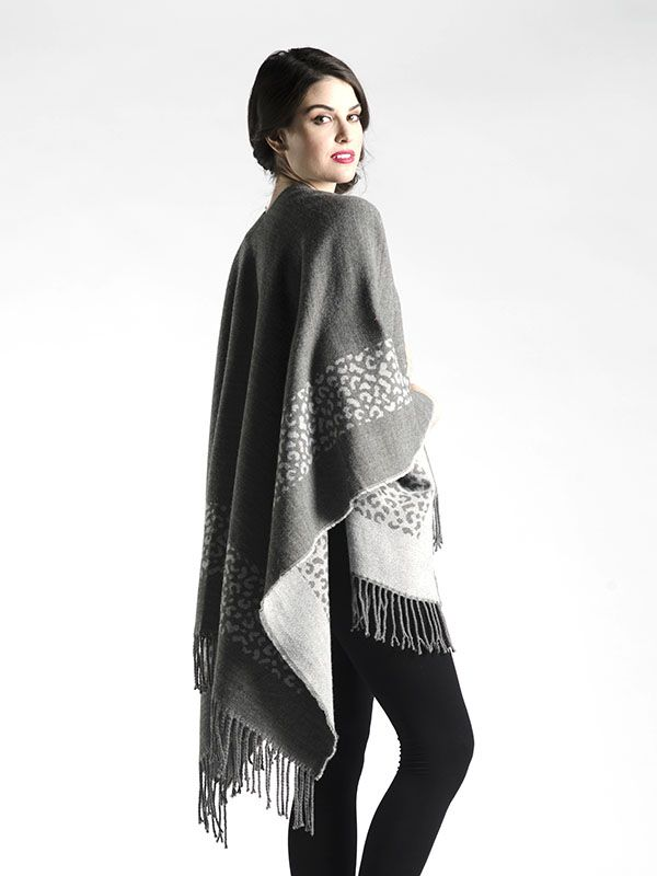 Oversized Outerwear Shawl with Fringe in Grey - A beautifully soft fabric, this oversized shawl can be worn as a cape or bundled up!  With beautiful animal pattern in the grey or colour blocked with neutrals in the black, you'll love how easy this piece is to throw over your shoulders as you're hurrying out the door!  Available in Black and Grey.