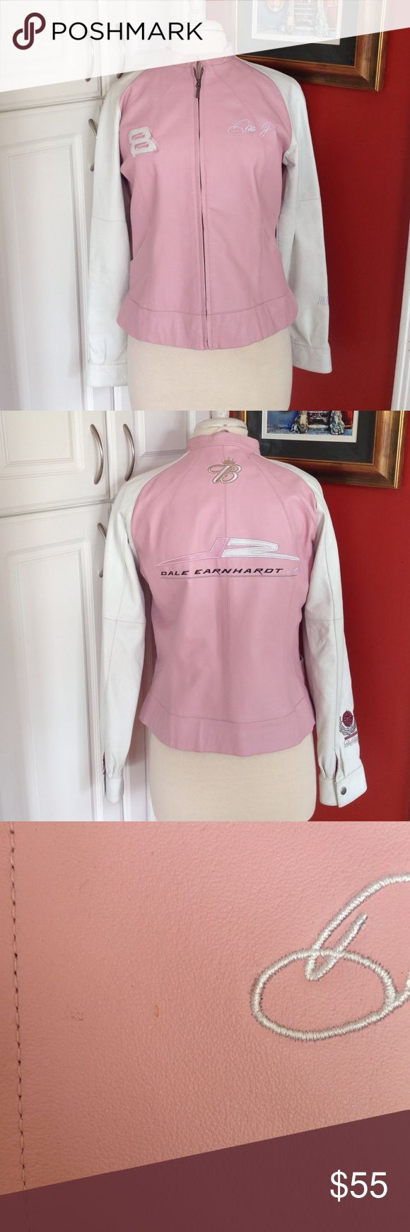 """Wilsons Leather Dale Earnhart Jr. Jacket Wilsons Leather Dale Earnhart Jr. NASCAR jacket, pink and white. Size medium. Measurements: shoulders: 16.5"""", bust: 19"""", length: 23"""", sleeve length: 28"""". Features: two front pockets, lined, snap sleeves, zipper closure. Pre-loved, some superficial stains (I believe it can easily be cleaned by a professional). Wilsons Leather Jackets & Coats"""