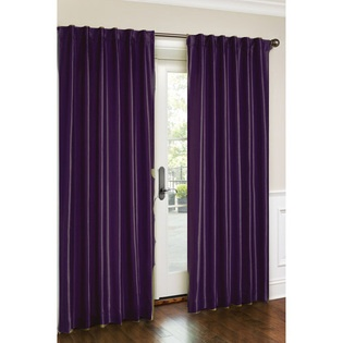 purple curtains with a grey wall