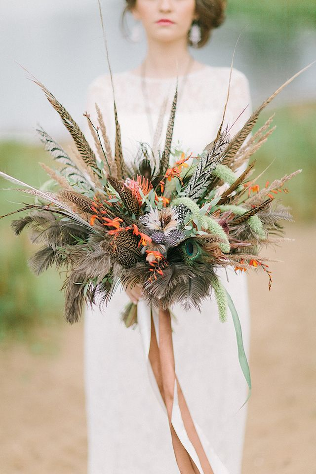 Bohemian bridal bouquet with feathers | Sofia Martynova Photography | see more on: http://burnettsboards.com/2015/12/sophisticated-bohemian-bride/