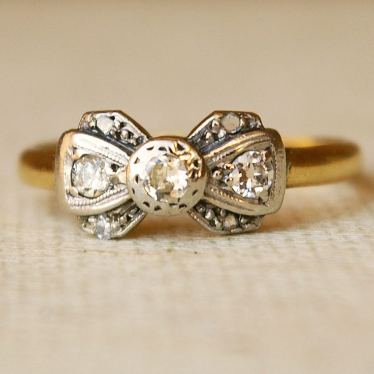 1920's Platinum, Diamond & 18k Gold Ribbon Bow Ring Size US 6. $365.00, via Etsy.