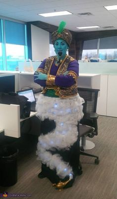 Genie Costume - I made this costume using a bag of Halloween spider webs and LED lights on a black skirt. I made all of the other elements as well. I fashioned the headpiece on a winter hat so it was easy to put on. I used theatrical makeup on my face. - Kelly