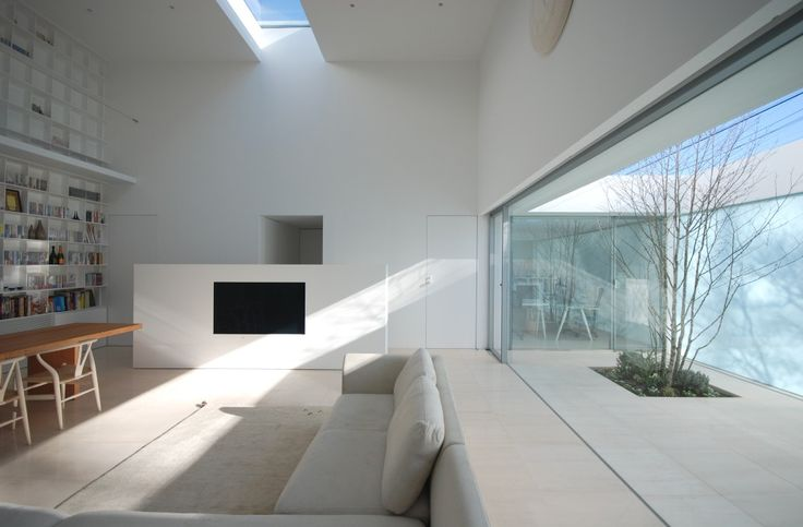 Library House / Shinichi Ogawa & Associates    Interesting way of combining workspace with leisure.