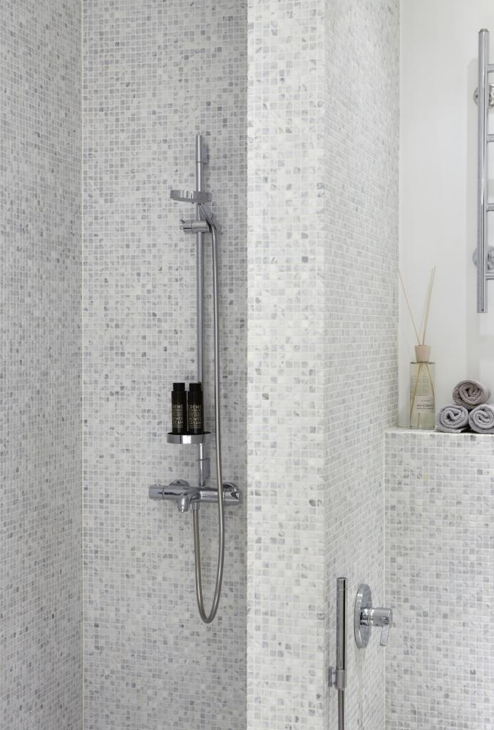 In this bathroom the walls and floors are made of Tulikivi carrara marble mosaics. Tulikivi's media