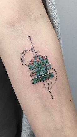 Little carousel tattoo by Baris Yesilbas