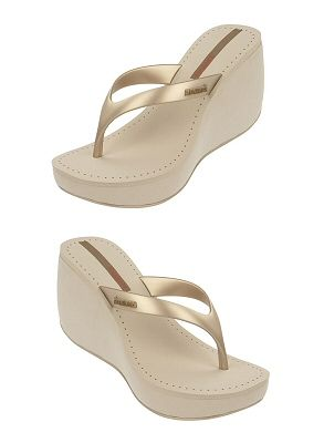 """Beige wedge flip-flop with gold straps. Platform measures approximately 1.5"""" and the heel 3.5"""" by Ipanema Flip Flops, $43.00"""