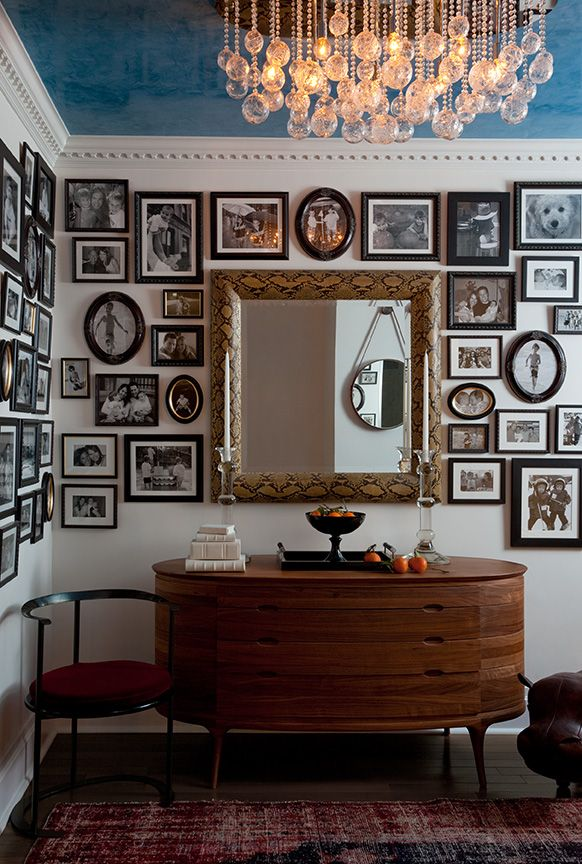 love this vintage-inspired gallery wall around a corner. designed by Daun Curry.