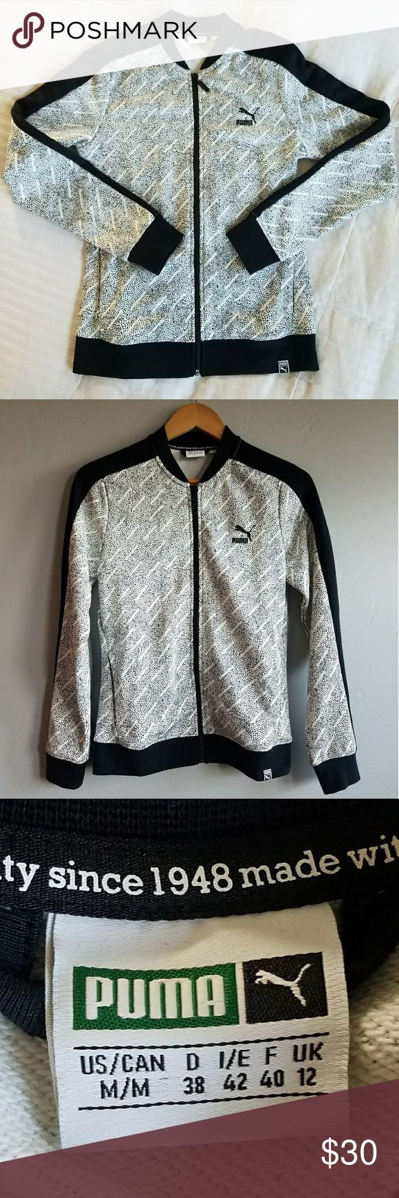 PUMA zip up Track Jacket Women's zip up Track Jacket with pockets. Featuring a really cool black and white speckled design. Size Small although tag says medium. Worn one time. In great shape. Puma Jackets & Coats Utility Jackets