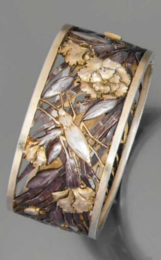 An elegant Art Nouveau silver and vermeil cuff bracelet, circa 1900. Decorated with insects amongst flowers and foliage. #ArtNouveau