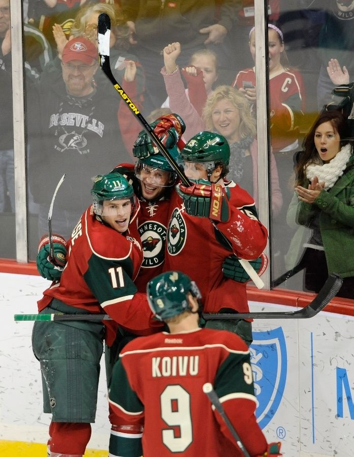 ST PAUL, MN - JANUARY 29: (L-R) Zach Parise #11, Tom Gilbert #77, Mikko Koivu #9 and Dany Heatley #15 of the Minnesota Wild celebrate a goal by Gilbert during the first period of the game against the Columbus Blue Jackets on January 29, 2013 at Xcel Energy Center in St Paul, Minnesota. (Photo by Hannah Foslien/Getty Images)