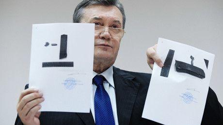 Former president of Ukraine Viktor Yanukovych, is seen here during a press scrum in Rostov Region Court where he testifies on February 2014 unrest in Kiev. The Rostov Region Court arranged a video link for Kiev's Svyatoshinsky Court to interrogate Mr. Yanukovych.© Sergey Pivovarov