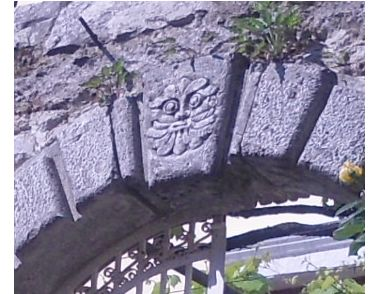 Stone ornament at top of the entrance gate
