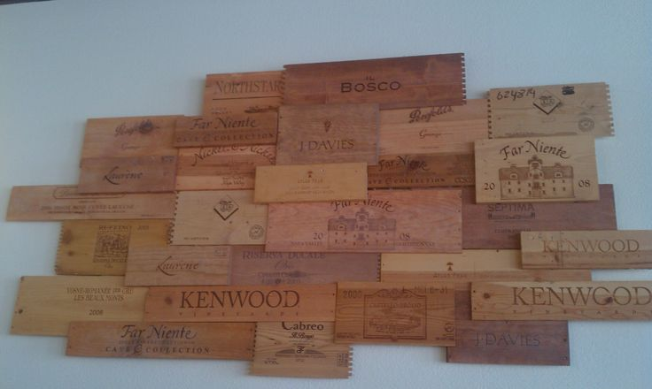 wine crate shelving | Koho Bistro in Eugene, Oregon upcycles wine crates for wall art