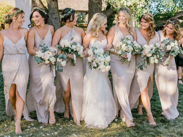 Bride and bridesmaids bouquets. Summer wedding. Neutral dress and bouquets, white, cream, ivory green