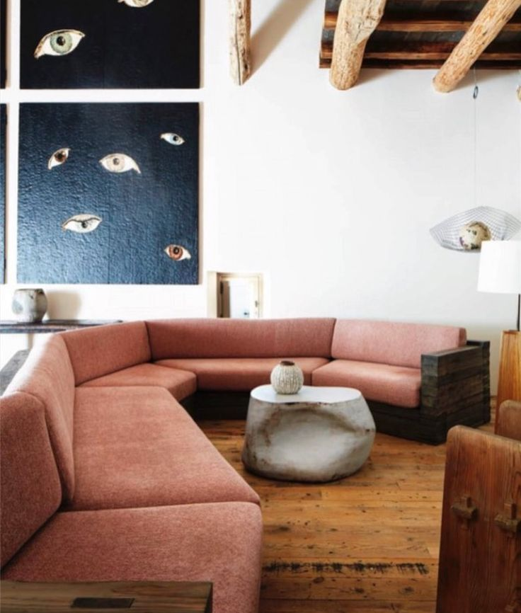 Chez Moi Apartments: Vintage Pink Sectional, Wooden Floor, White Walls, Black