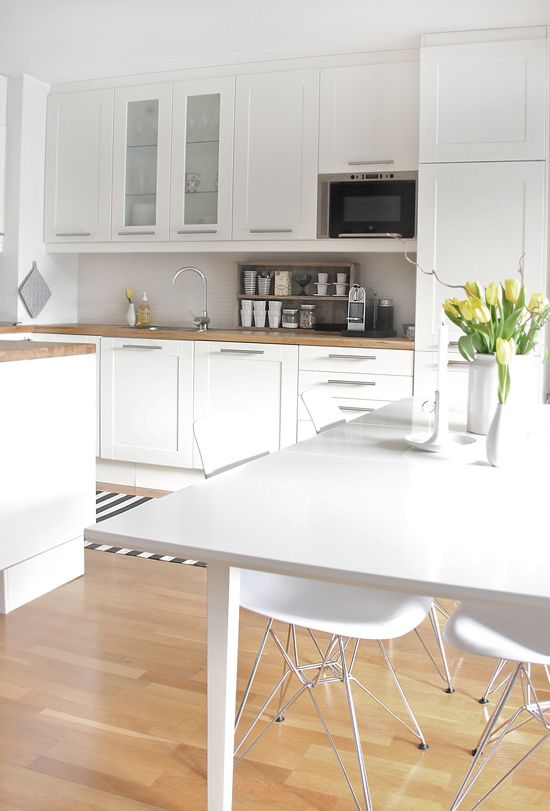 white cabinets with light coloured wood