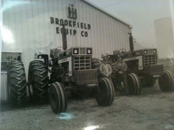 """Pair of brand new IHC 1466's fresh from factory with factory duals and IH fender mounted radio and 12 IH 100 lb front weights back in 1973 at Missouri dealer....so cool. Thanks to Facebook follower Robbie H. for the pic, Robbie got pic from a friend in Missouri. Friend said both of these 1466's still working Missouri farm fields today! Robbie H. from an IHC family, his late father who passed away in 1980 owned IHC dealership in south-central Kentucky """"Hancock Tractor Sales"""""""