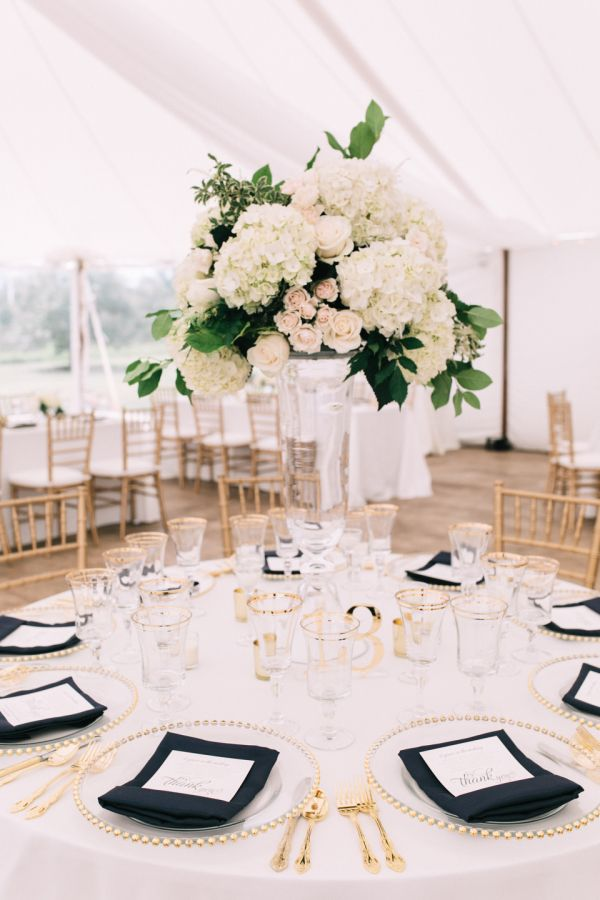 Hydrangea, rose and peony centerpiece: http://www.stylemepretty.com/maine-weddings/stockton-springs/2016/11/01/classic-maine-wedding-with-glam-twist/ Photography: Emily Delamater - http://emilydelamater.com/