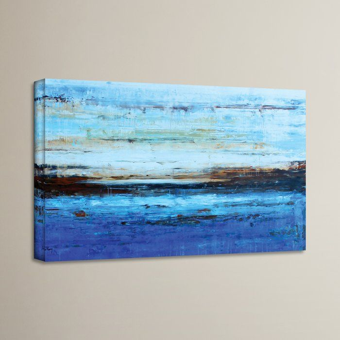 Evoke the serenity of shoreline waves rolling in with this artful canvas print, showcasing a blue-hued beach scene. Set it above a coastal-inspired foyer console vignette, or let it tie together your nautical-chic den ensemble.