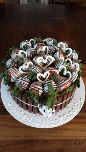 Kit kat cake with chocolate dipped strawberries -- cute for a bachelorette party too!