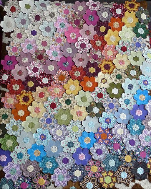 Scrap hexagon patchwork quilt by brazenjane, via Flickr
